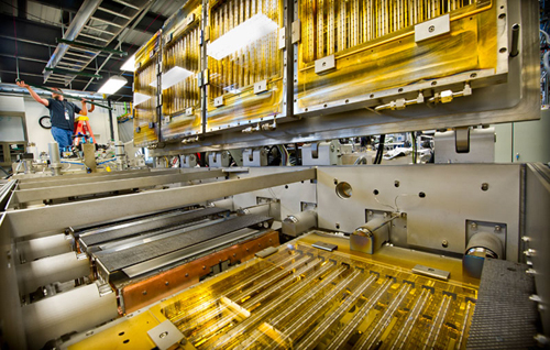 Ampulse Corporation is installing a pilot production line in the Process Development Integration Laboratory (PDIL) at NREL.: It represents a new, less wasteful way of making solar cells and should result in less expensive devices. Credit: Dennis Schroeder