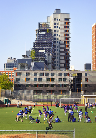 Once a  former brownfield site, the triangular lot of Via Verde is next to the South Bronx High School: and its adjacent field south of the development.  Photograph © David Sundberg/ESTO