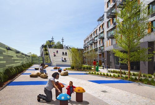 Children's play area is designed with safety surface located in the courtyard.: At the heart of Via Verde are a series of gardens that begin in the courtyard then spiral up through a series of green roofs and south facing solar panels.The rooftop gardens dissipate heat and absorb rainwater runoff, using a reclamation system that recycles water for irrigation, while providing opportunities for active gardening, fruit and vegetable cultivation, relaxation and social gathering. The facade features aluminum, cement, and wood panels with panoramic windows, sunshades, and courtyard balconies. A landscaped courtyard, the green roofs, a fitness center, and day-lit stairs promote healthy lifestyles and provide opportunities for physical fitness.        Photograph © David Sundberg/ESTO