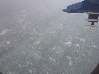"An example of what can be filmed is this image of high waves, white caps and foam streaks off the west coast of Scotland: during storm ""Friedhelm"" on 8th December 2011 as photographed from about 450m above sea level onboard the UK research aircraft FAAM BAe146. Photographed in December 2011 by Peter Knippertz, courtesy of Wikipedia."