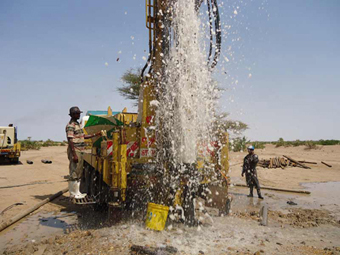 Water gushing out of a borehole at Napuu area during the flushing process.: Photograph © UNESCO/Nairobi Office