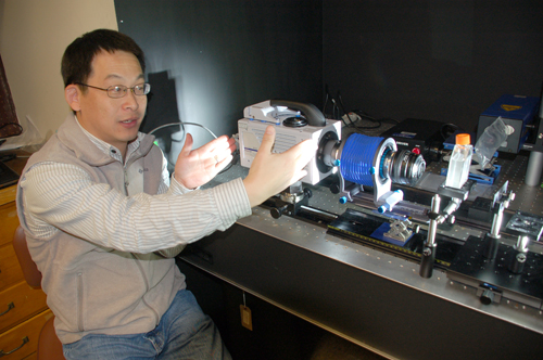 WHOI scientist Houshuo Jiang with the new high-speed, high-resolution video system he developed.: Photograph by Alison Satake, WHOI courtesy of NSF