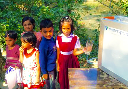 Children getting water from a Watersprint solar purification plant.: Thanks to an innovative energy-saving solar-based water purification technology, rural areas in Bangladesh are now able to access safe drinking water. Photo: K. M. Persson Published: 12/02/2016