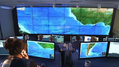 The British government will work with Pew and the Swiss-based Bertarelli Foundation to monitor the marine reserve using: Pew's Project Eyes on the Seas and its Virtual Watch Room technology. This groundbreaking system uses satellites and other data sources to provide a live view of action on the water and enables officials to detect illegal fishing within moments of its occurrence. The information can be used to enforce the prohibition on commercial fishing within the reserve's boundaries. Credit Satellite Applications Catapult