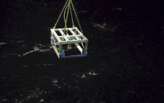 The Fish Spy rig is shown over the ocean.: Courtesy of Paula Dell/NSF/PolarTREC