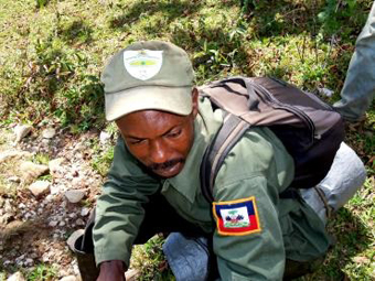 A park ranger, working as a guide for tourists.: Photograph courtesy of IDB