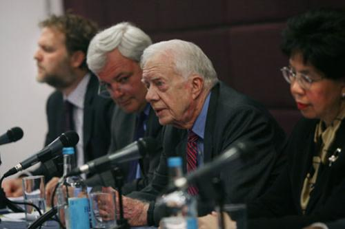 """The U.K. has shown its willingness and staying power to help eradicate this debilitating disease.: I call on other donors to match their efforts,"" President Carter said. (Left to Right: Minister O'Brien, President Carter, and Director-General Chan) Photograph courtesy of The Carter Center/ J. Cobb"
