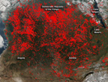 "Agricultural Burning: FIGURE 4.5  Agricultural burning in about 4 million square kilometers throughout central Africa.  Fires burning in the southern region of the Democratic Republic of the Congo, Zambia and Angola.  Actively burning areas outlined in red.  Photo from the NASA's Aqua satellite June 3, 2016. NASA, NOAA, and the U.S. Department of Defense.  https://www.nasa.gov/image-feature/goddard/2016/fires-in-angola-zambia-d.... From Chapter 4: ""Water, Food and the Environment,"" by Robert Wyman and Guigui Yao."