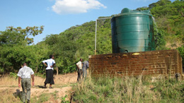 Gravity fed water system connected to a local spring: in Kaombe village (Mpika district) from images on Water, sanitation and hygiene in Zambian schools, photograph courtesy of Jay Graham