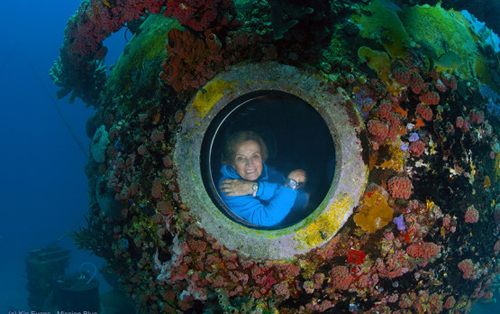 "Dr. Sylvia Earle, ""Her Deepness"" peering out from a porthole.: Feature Photograph by Kip Evans / Mission Blue"