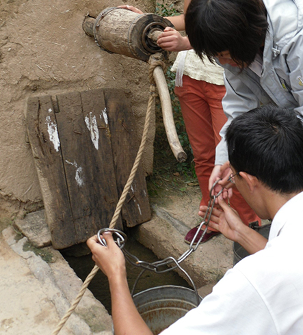 In 2009, together with the team from Peking University,: we conducted social fieldwork in a village of Jingchuan, Gansu province. The rural villagers had no access to tap water, and they had to collect water from the well by buckets for daily usage.