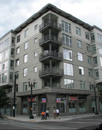 Mixed-use multifamily building.  Developments on the streetcar line in the Pearl District of Portland, Oregon,: give residents easy access to universities, a major hospital, and the central business and shopping districts. Photograph source: Kyle Gradinger via Flickr.com.